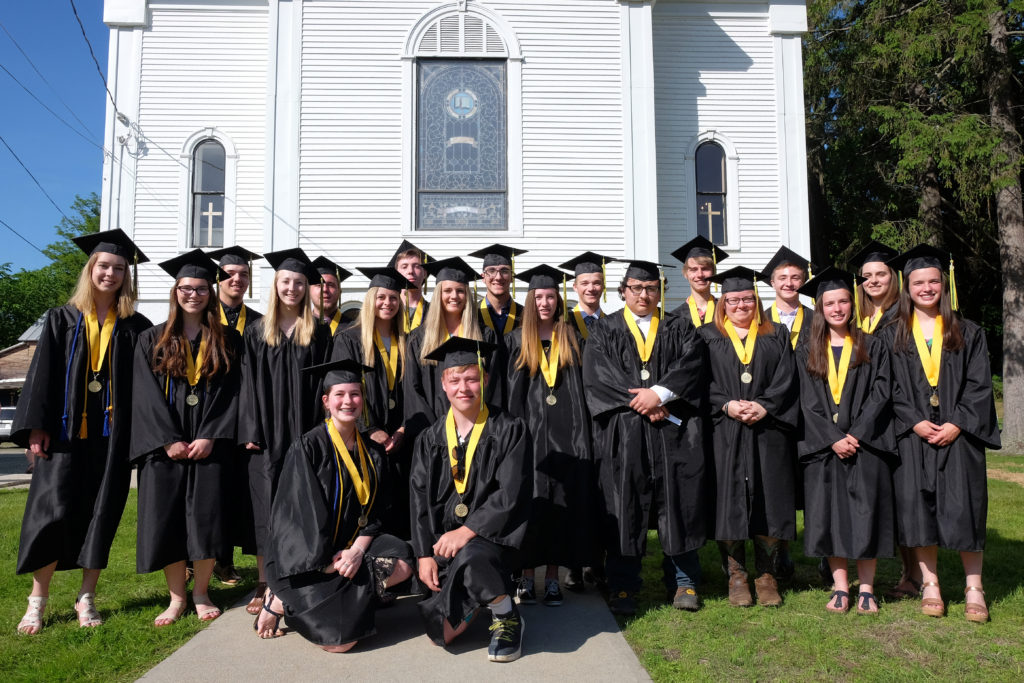 First graduating class of seniors from White River Valley School, posing after Red Door Church's annual Baccalaureate service in 2019